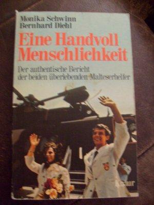 Bildtext: Eine Handvoll Menschlichkeit von Monika Schwinn, Bernhard Diehl